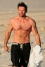 "Actor Hugh Jackman goes for another morning swim in Sydney with his personal trainer after the premiere of his new film ""Real Steel"""